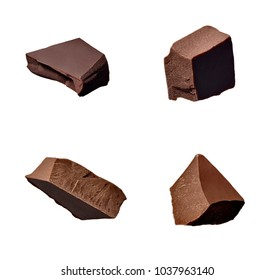 close up of chocolate pieces falling on white background