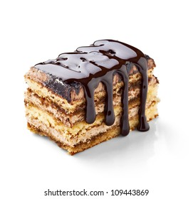 close up of a chocolate syrup on a cake on white background