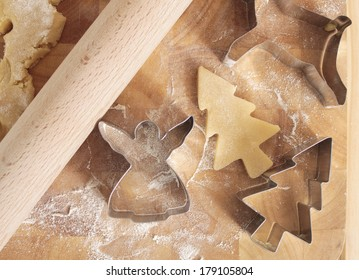 close up of Christmas cookie cutters and dough