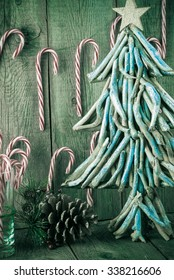 Close up of Christmas decoration with candy cane and Christmas stylish tree.
