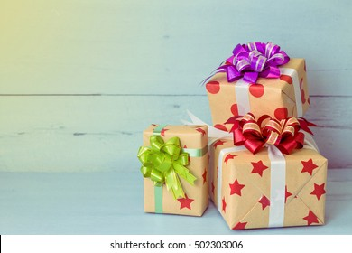 close up of Christmas present over  blue wooden background  with copy space