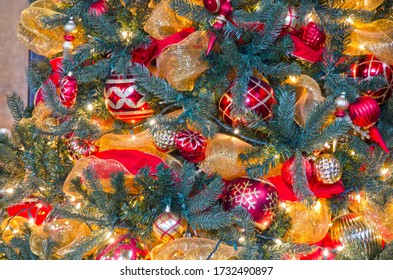 Close up of Christmas tree decorations, lights and balls