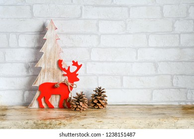 Close up  christmas tree and deer in vood, decorate for christmas put on nature wood and background white brick, invation card for christmas and newyear concept, happy time with family,