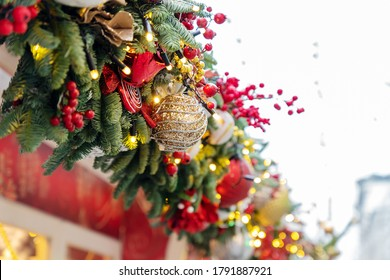 close up of christmas trees decoration with toys and garlands. City festive decor during winter holidays