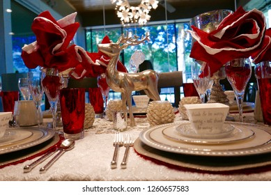 Close up of Christmas-themed dinner table arrangement and decorations