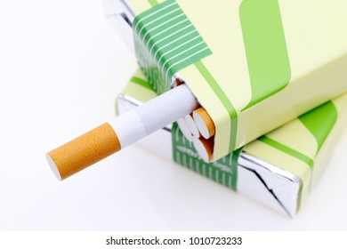 Close up of cigarette packet on a white background