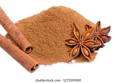 Close up of cinnamon powder and sticks with star anise on white background