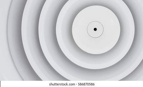 Close up circle air grill on ceiling.