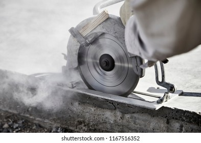 Close up of a circular saw cutting a concrete slab
