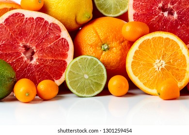 Close up of citrus fruits. Pieces of lemon, lime , tangerine , pink grapefruit and orange.