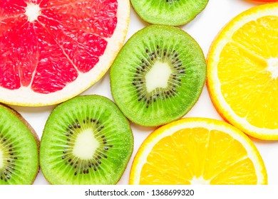 close up of citrus slice, kiwi, oranges and grapefruits isolated on white background. Fruits backdrop