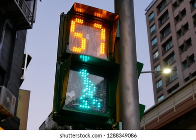Close up of city traffic light turns on green for pedestrian walking