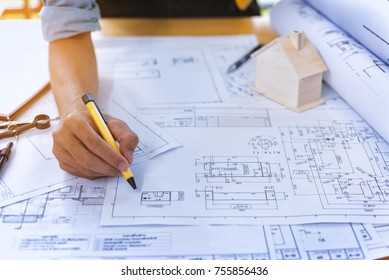 Construction worker pointing up stock photos images photography close up of civil male engineer asian working on blueprint architectural project at construction site at malvernweather Images