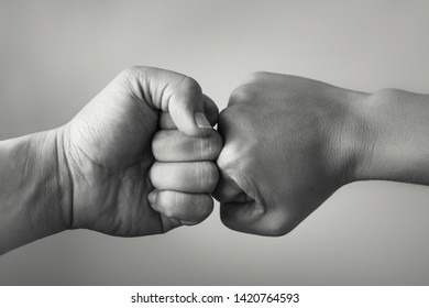 Close up clash of two fists clashing . Conflict Concept