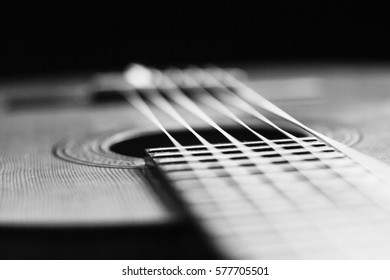 Close up of classical guitar, black and white