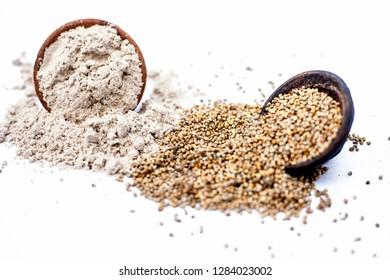 Close up of clay bowl of barley or pearl millet with its flour in a another bowl isolated on white.