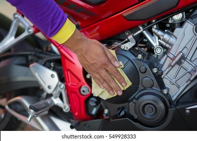 close up cleaning motorcycle engine