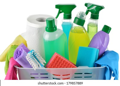 Close up of cleaning products and supplies in a basket. Cleaners, microfiber cloths, gloves in a basket isolated on white background. Cleaning kit.