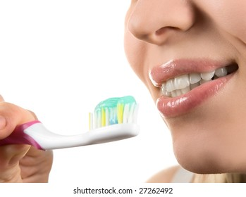 Close up of cleaning teeth on white
