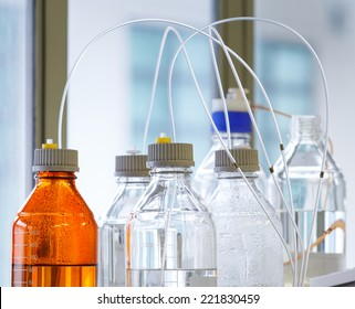 Close up clear and amber color bottle with plastic hose for High performance liquid chromatography - HPLC