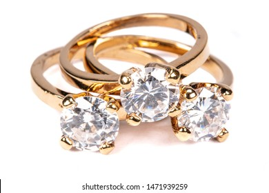Close up of clear stone gold rings