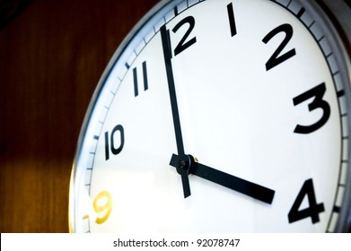 close up clock on wall at time four o'clock