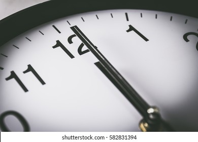 Close up of clock with selective focus at 12 Oclock