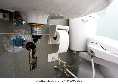 Close up of Clogged in pipes of Basin or sink in a bathroom, Clearing a Clogged Bathroom Sink  in a bathroom
