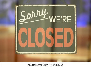 Close Up of Closed Sign Hanging in Window