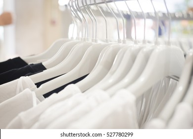 close up clothes hang on clothes rack in clothing store with sweet tone