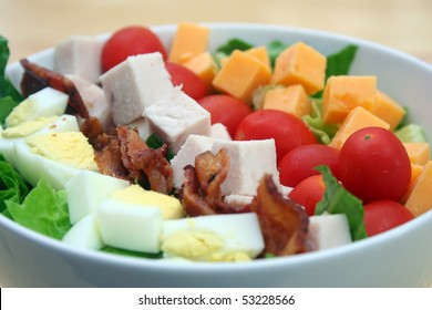 Close Up of Cobb Salad in a White Bowl