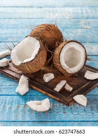 close up of a coconuts on old wooden background
