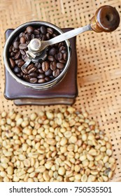 Close up of coffee beans and coffee beans in coffee grinder