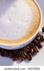 Close up of coffee cup with bean on white background