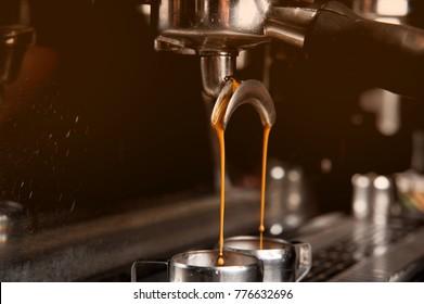 Close up coffee machine preparing cup of coffee. Process of preparation of coffee, a closeup. Coffee machine espresso.
