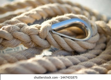 close up of a coiled natural hemp rope with a hard splice in one end