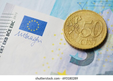 Close up coin, fifty cen on the euro banknotes. image for background, wallpaper and copy space. financial and economy of euro zone.  banking of trading market .