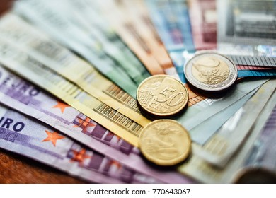 Close up coin, fifty cen on the euro banknotes. image for background, wallpaper and copy space
