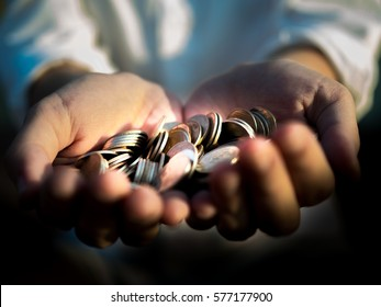 Close up coins in hand for lending, financial concept