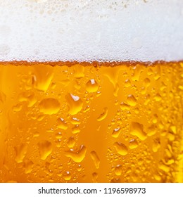 Close up of cold beer in a glass. Beer background