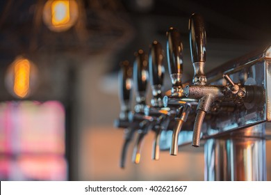 Close Up of Cold Beer Tap (Selective Focus Point)