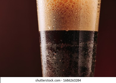 Close up of cold brew nitro coffee. Lot of texture and drops. Macro shot. Poster with copy space.
