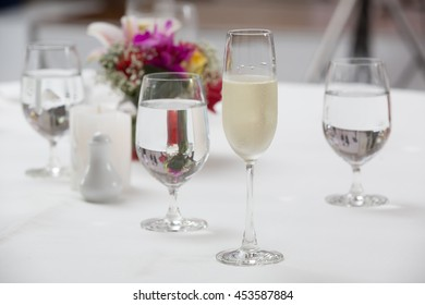 close up of cold champagne and water in a glass