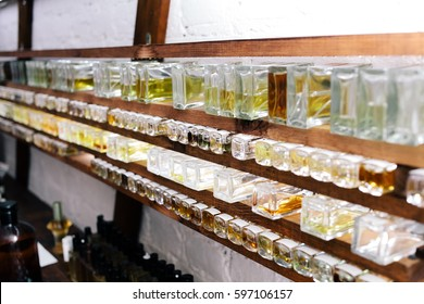 Close up color bottles on the shelf in old perfume laboratory. Flasks and examples of odor in the perfume laboratory and shop.