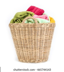 close up color mix  towel in wicker baskets on white background