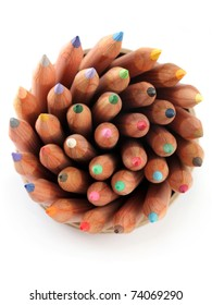 Close up of color pencils with different color over white background.