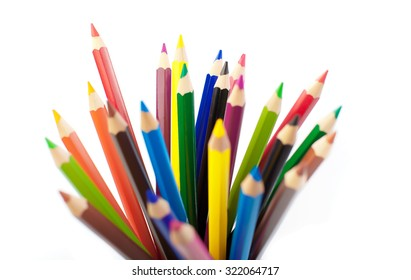 Close up color pencils isolated on white background.