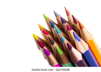 Close up colored pencils on white isolated background