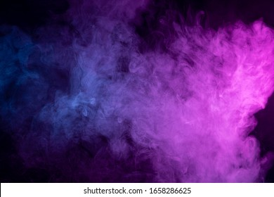 close up of colorful  blue and pink steam smoke in mystical and fabulous forms on black background.Mocap for art
