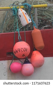 Close up of colorful buoys hanging on the side of a fishing boat in Saint Bride's, Newfoundland and Labrador